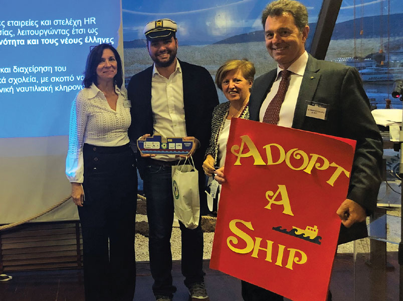 Athens College Teacher Chrysostomos Lefteratos wearing Captains hat rewarded for making the pilot program a success